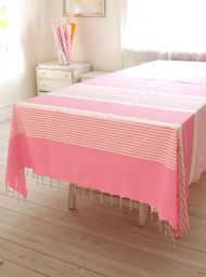 Pink and white striped bedspread and couch cover