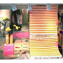 Todays window with striped runner rug in orange and ivory white, designed by kira-cph.com and hand-woven by our female weaving cooperative in Morocco. Our kira-cph rugs and runner rugs are woven in Amy size on demand. This runner rug is 70x210 cm, price: 2350 dkk. See more design options on www.kira-cph.com #runnerrugondemand #rugsondemand #orangeandwhitestripedrunnerrug #colorfulrunnerrug #colorfulrug
